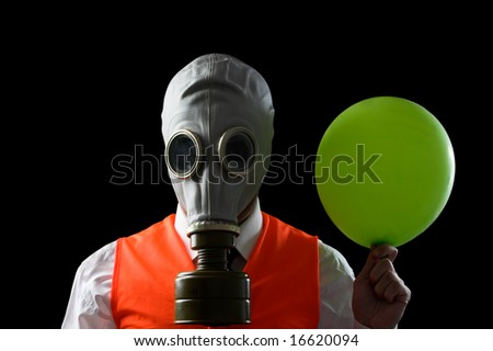 man in mask wearing a high visibility vest holding a balloon - stock photo