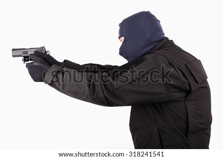 Man in mask with a gun  on white background. - stock photo