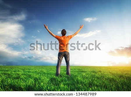 Man in meadow. Conceptual design. - stock photo