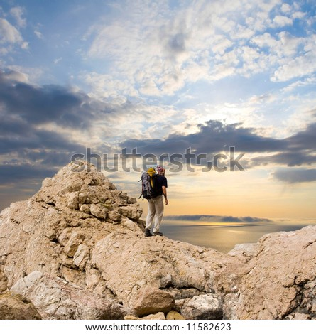 man in meditation on top of the mountain
