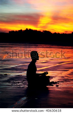 Man in meditation under the setting sun