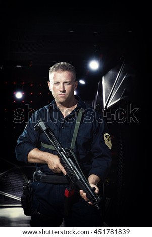 Man in military outfit holding a  machine gun  - stock photo