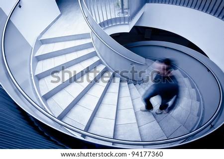 Man in motion blur walking up steps - stock photo