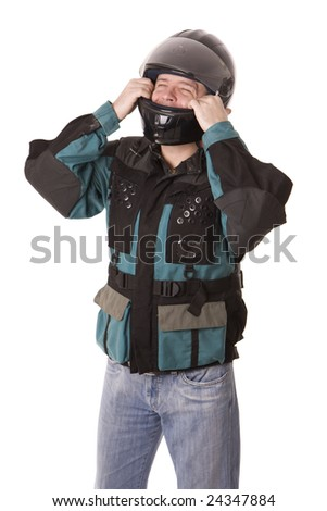 man in motor-cycle jacket founding helmet