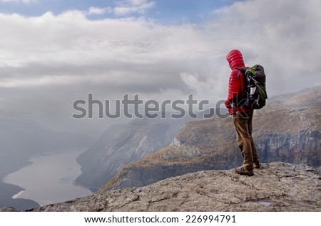Man in mountains, Norway  - stock photo