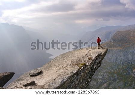 Man in mountains, Trolltunga , Norway  - stock photo
