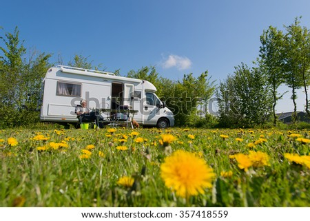 man in nature traveling with mobil home - stock photo