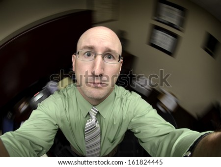 Man in office looking towards heaven looking for heavenly help - stock photo