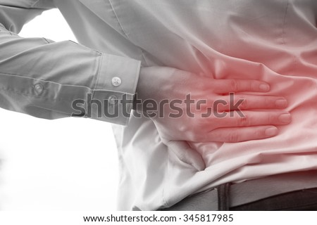 Man in office uniform having back pain issue / back injury - stock photo