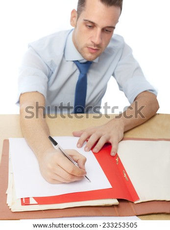 man in office writing - stock photo