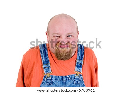 Man in overalls with grumpy face