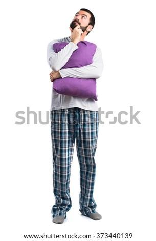 Man in pajamas thinking - stock photo