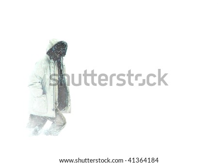 Man in Parka Walking in Arctic Blizzard Whiteout Snow Conditions - stock photo