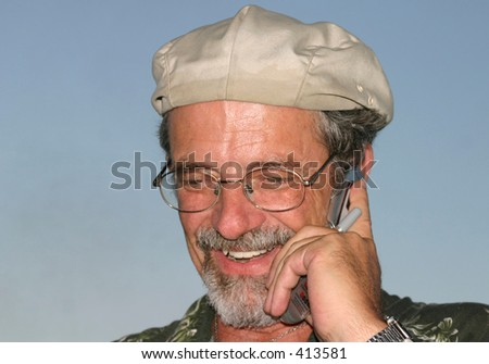Man in Pleasing Conversation on Cell Phone - stock photo