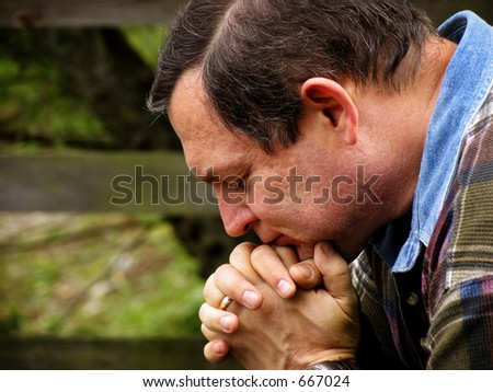 Man in prayer color version - stock photo