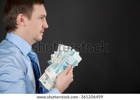 man in profile holding money