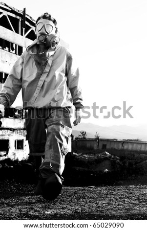 Man in protective gas mask - stock photo