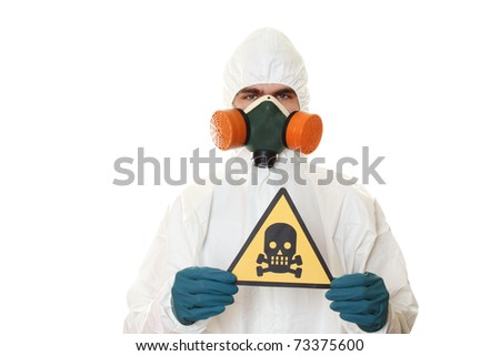 Man in protective suit, a mask and a respirator. Holds a sign with a skull. Isolated on white