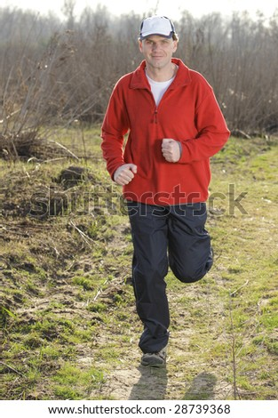 Man in red shirt while out jogging