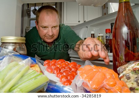 Man in Refrigerator - stock photo