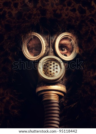 Man in respirator in the darkness - stock photo
