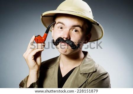 Man in safari hat in hunting concept - stock photo