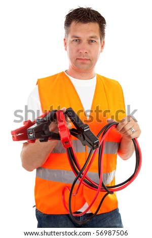 man in safety vest holding car jumper cables over white background - stock photo