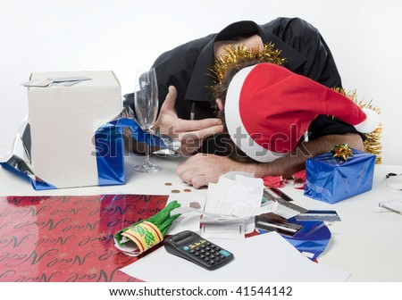Man in Santa Claus hat looking depressed about his finances - stock photo