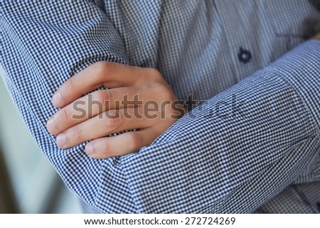 man in shirt folded his arms - stock photo