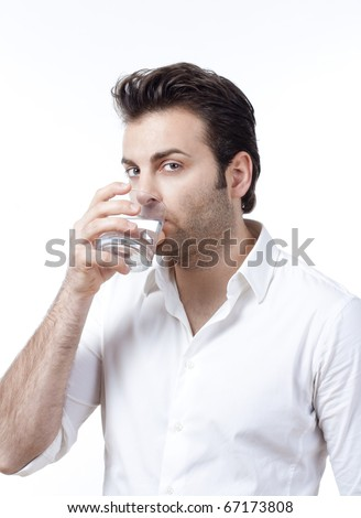 man in shirt holding glass of water looking up - isolated on white