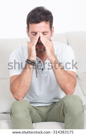 Man in shirt with stuffy nose having an allergy - stock photo