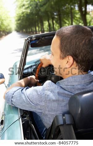 Man in sports car - stock photo