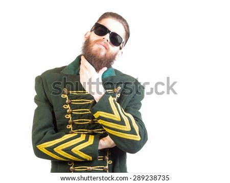 Man in strange outfit with sunglasses over isolated background. - stock photo