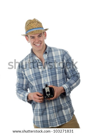 man in straw hat poses taking a picture with a retro box camera - stock photo