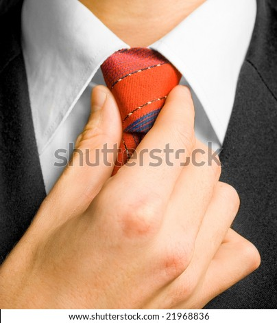 Man in suit and cravat. Shallow DOF. - stock photo