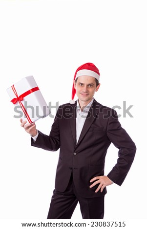 man in suit and hat with Christmas gift in hand on white background