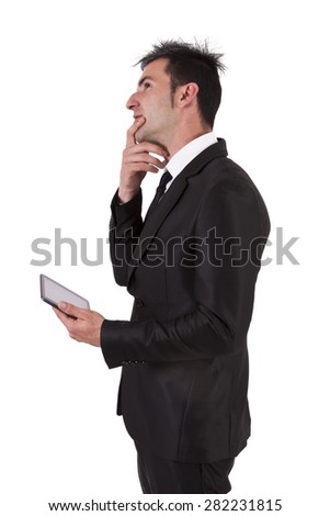 man in suit and tablet thinking
