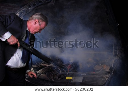 Man in suit and tie goes berserk and points a gun at his smoking car.