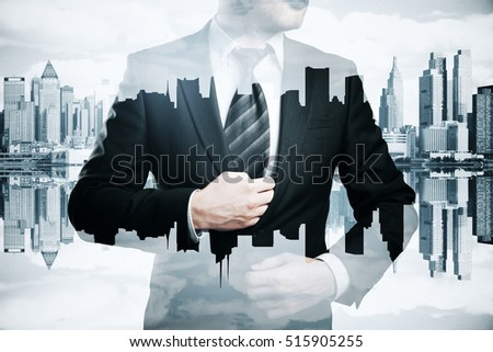Man in suit and tie on abstract city background. Research concept. Double exposure