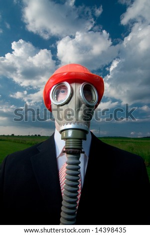 Man in suit and tie with gas mask and red hat against blue sky and clouds. - stock photo