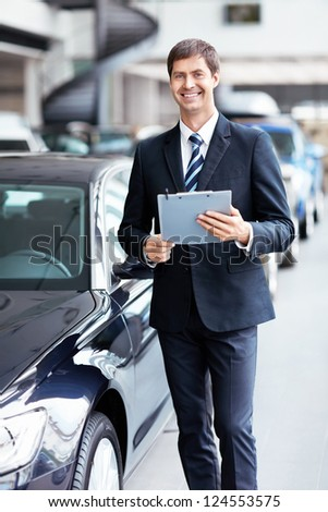Man in suit at the car - stock photo