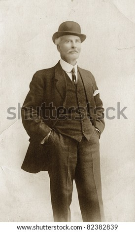 Man in Suit & Bowler Hat, noise added - stock photo