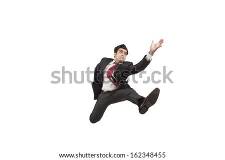 Man in suit chasing his goals - stock photo