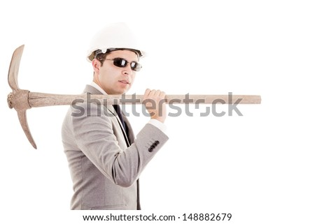 Man in suit displaying pick-axe - stock photo
