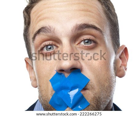 Man in suit gagged - stock photo