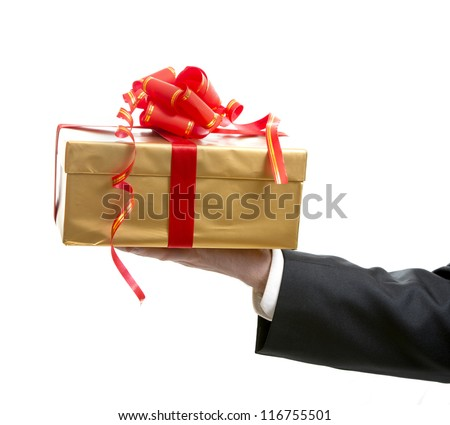 Man in suit giving a present close up - stock photo