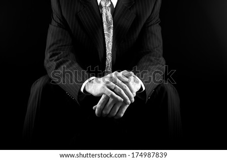 Man in suit hands fragment photo in black and white, hands close up isolated on black, groom hands fragment, grooms hands, mans hands with ring fragment, artist  - stock photo