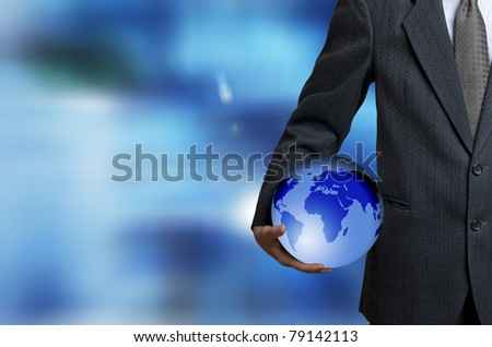 man in suit holding an earth globe