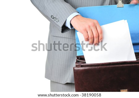 Man in suit holding blank sheet of paper