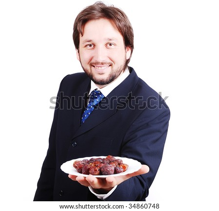 Man in suit holding dates plate in front - stock photo